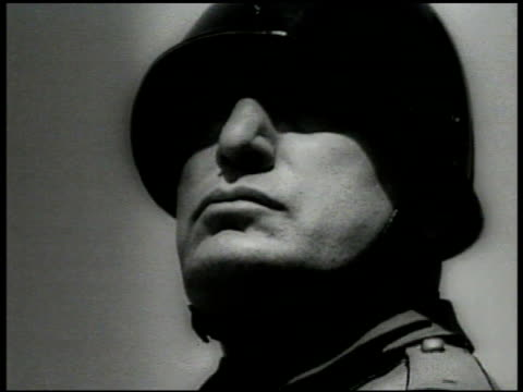 italian dictator benito mussolini standing. officer pietro badoglio looking through telescope from bunker. soldiers charging across field. variation... - 1935 stock-videos und b-roll-filmmaterial