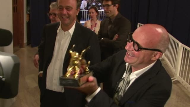 """italian director gianfranco rosi's documentary """"holy gra"""", which looks into everyday life off a rome ring road, won a surprise golden lion for best... - documentary film stock videos & royalty-free footage"""