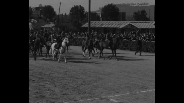 stockvideo's en b-roll-footage met italian fascist military marches by during parade marking the 10th anniversary of fascism in italy / benito mussolini and others arrive on horseback... - 1930