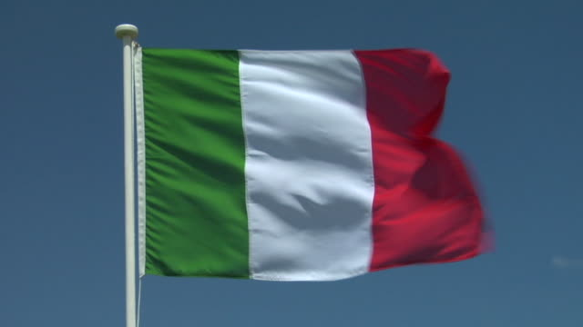 CU, Italian flag flapping against sky