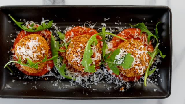 italian food - arancini balls with pumpkin, rosemary, three cheeses and romesco - croquette stock videos and b-roll footage