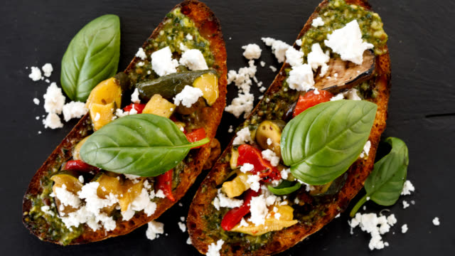italian food - bruschetta - feta stock videos & royalty-free footage