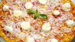 Italian food. Pizza with tomato sauce, salami, basil, cheese. Slow motion. HD