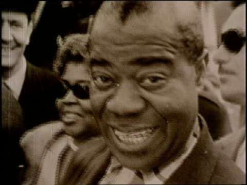 italian jazz musicians play upright bass and drums while louis and lil armstrong walk through a crowd and sign autographs - 1960 stock videos & royalty-free footage