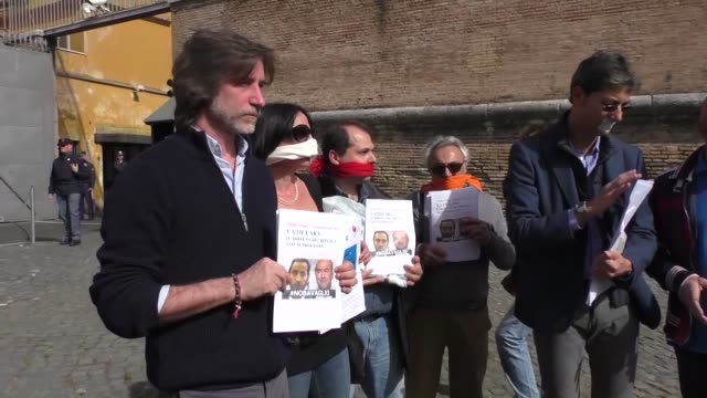 Italian journalists' union FNSI and the freespeech advocacy group Articolo 21 demonstrate outside the Vatican before a session of the socalled...