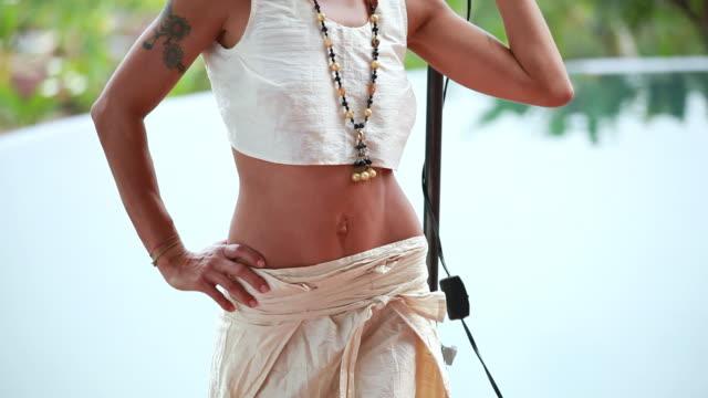 ms tu italian model with tattoo on arm under lighting umbrella with pool / montezuma, punteranes, costa rica - kelly mason videos stock videos & royalty-free footage