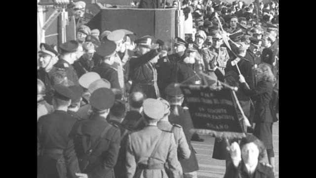 italian narration throughout] vs motorcade with open car with galeazzo ciano drives past spectators line streets and waving fascists flags, banner... - only girls stock videos & royalty-free footage