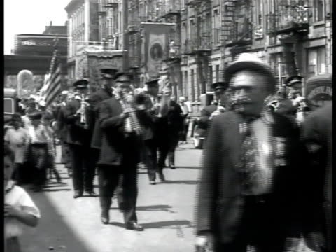 italian parade w/ band walking down street w/ elevated train bg italian flag hanging from window above shop pan building woman hanging flag out of... - italian flag stock videos and b-roll footage