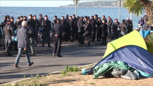 Italian police cleared a camp of migrants and activists from the border of France and Italy on Wednesday with the occupants moving to rocks on the...