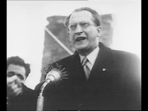 italian prime minister alcide de gasperi speaks at podium at campaign rally in turin / pan crowd / de gasperi speaks / crowd / montage line of people... - communist flag stock videos & royalty-free footage