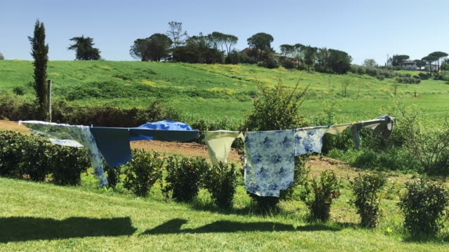 italian rural scene: clothes hanging in tuscany - hanging stock videos & royalty-free footage