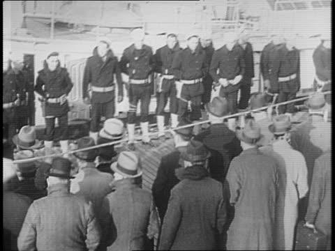 italian ships seized in baltimore / coast guard walking on the deck of a ship / coast guard inspecting equipment aboard ship / coast guard escorting... - anno 1941 video stock e b–roll