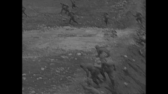 vs italian soldiers fire rifles from trenches artillery guns from rocky terrain / vs from high above soldiers just tiny specks run across patches of... - battle stock videos & royalty-free footage
