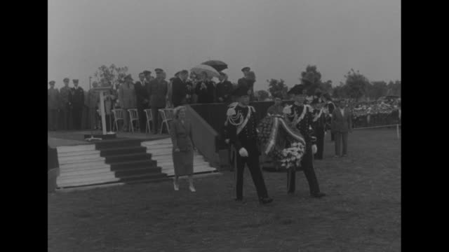 italian soldiers in fancy dress uniforms carry wreath towards fence / us ambassador to italy clare booth luce walks behind soldiers carrying wreath... - luce stock videos & royalty-free footage