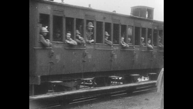 italian soldiers stand on train platform and wave as french soldiers and military trucks in troop trains move by - piedmont italy stock videos & royalty-free footage