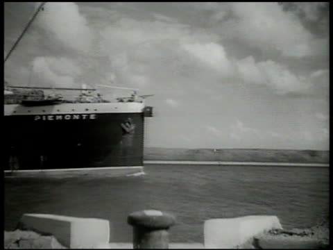 italian transport ship passing in suez canal. italian soldiers waving from crowded deck. egypt, mobilization, mobilizing, fascist italy. - suez canal stock videos & royalty-free footage