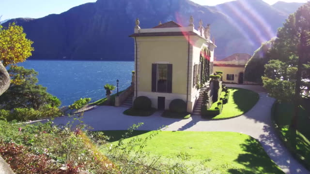 italian villa and gardens on lake como - standing water yard stock videos & royalty-free footage