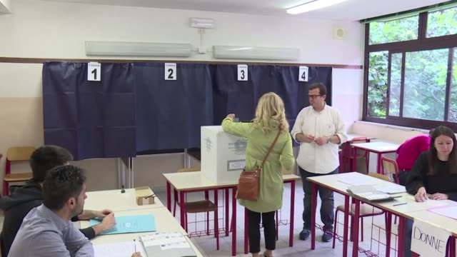italian voters cast their ballots in milan as european elections take place throughout europe for the 21 member states who have not yet voted - cast member stock videos and b-roll footage