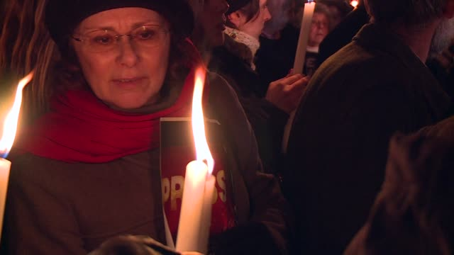 italians gathered outside the french embassy in rome thursday for a candle lit vigil following the deadly attack on french satirical magazine charlie... - materiale cartaceo video stock e b–roll