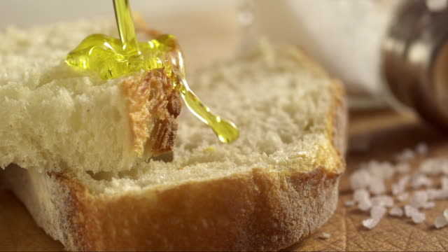 italien olive oil pouring on white bread bruschetta