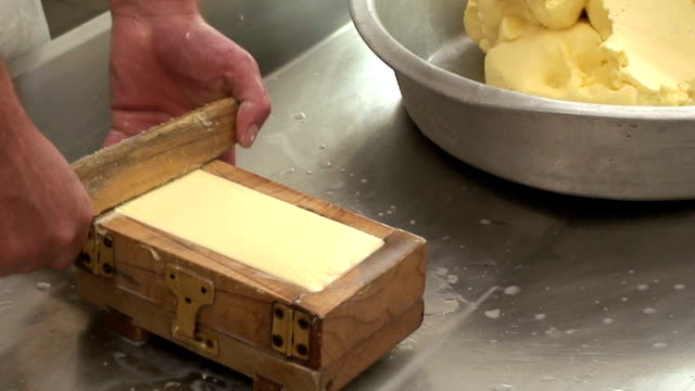italy, dairy farm in the mountain hut, preparation of butter - block shape stock videos & royalty-free footage