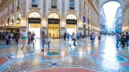 Italy evening illuminated milan city famous galleria center panorama 4k timelapse