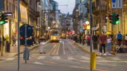 Italy evening illuminated milan city traffic street panorama 4k timelapse