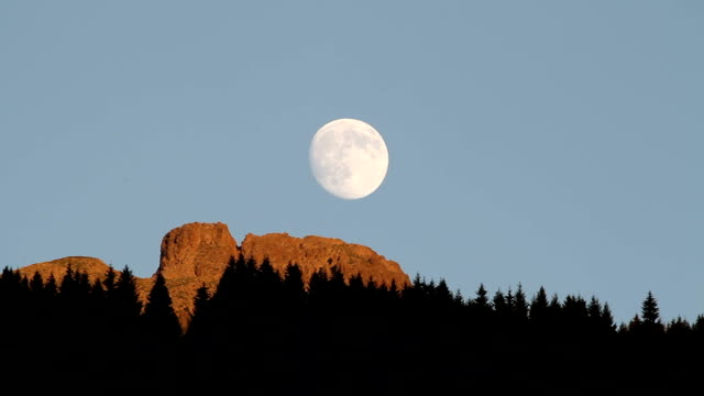 Italy, Fiemme valley, Cavalese, moon at sunset on the Dolomites