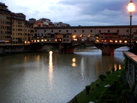 ms, zi, cu, italy, florence, ponte vecchio at dusk - ponte stock videos & royalty-free footage