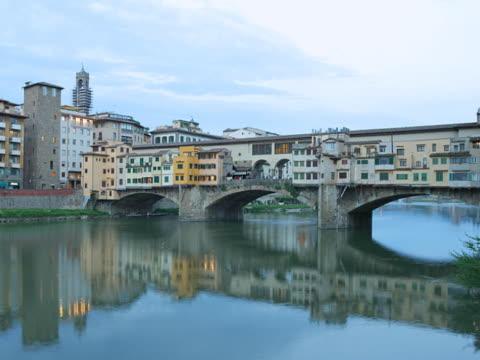 italy, florence, ponte vecchio at twilight - ponte stock videos & royalty-free footage