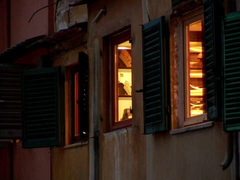 cu, italy, florence, windows in ponte vecchio at dusk - ponte stock videos & royalty-free footage