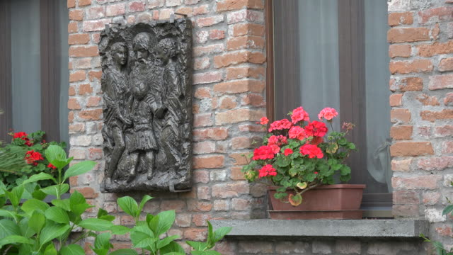 italy flowers in window and plaque on wall - window box stock videos & royalty-free footage