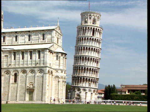 Italy Pisa Ancient boats discovered ITALY Pisa EXT Buildings including leaning tower in square Leaning tower of Pisa Leaning tower with crane in...