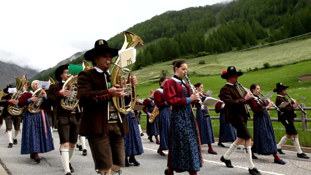 Italy, Schnalstal, Senales valley, parade of the brass band in traditional Tyrolean costumes