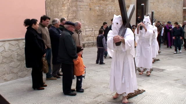 italy, troia, easter celebration, the hooded men with chains on their feet, carrying the cross - religious celebration stock videos & royalty-free footage