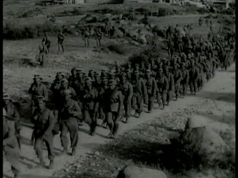 italy troops in full gear marching on hill ms hut burning on fire mountain bg ms ethiopian emperor haile selassie i riding on horseback w/ other... - freizeitreiten stock-videos und b-roll-filmmaterial