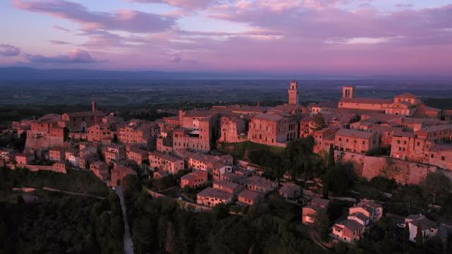 italy, tuscany, siena province, montepulciano illuminated at sunset - montepulciano stock videos & royalty-free footage