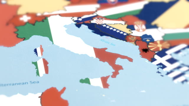 italy with national flag on world map - europa continente video stock e b–roll
