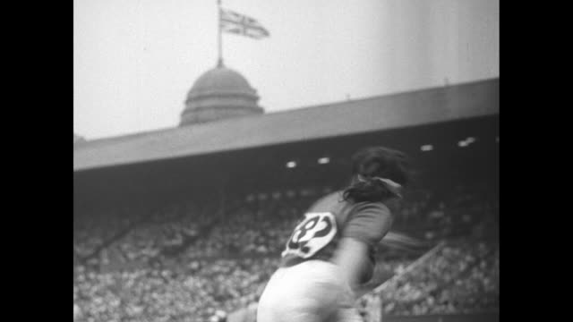 Italy's Edera Gentile throws discus at Wembley Stadium during Summer Olympics in London officials measure her throw / 2shot Japanese sailors in...