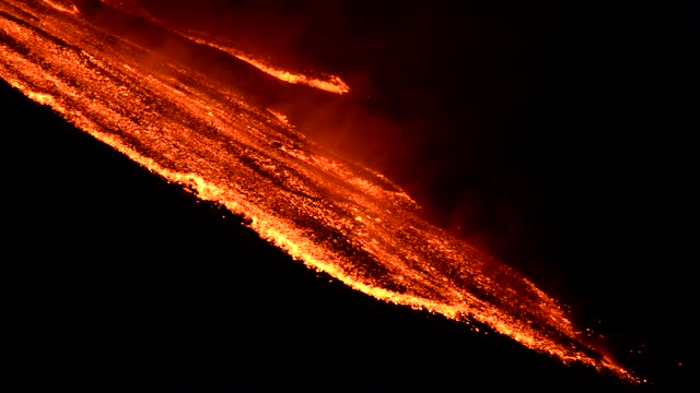 italy's mount etna on sunday night continued to spew lava and ash into the sky. europe's most active volcano on sicily island started to erupt on... - 16 17 years stock videos & royalty-free footage