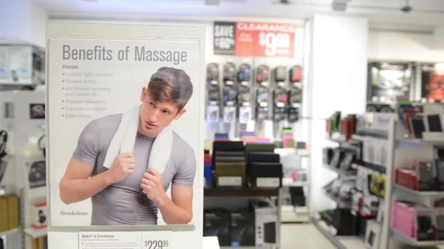 items are displayed for sale in a brookstone inc store at the concourse of rockefeller center in new york, us, shots of various massagers and massage... - zurücklehnen stock-videos und b-roll-filmmaterial