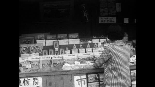 items for sale in hiroshima tourist gift shop; 1958 - nuclear bomb stock videos & royalty-free footage