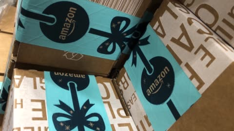 stockvideo's en b-roll-footage met items in 'amazon prime' branded packaging are seen at the amazon fulfillment centre on november 13, 2018 in hemel hempstead, england. the online... - shopping centre