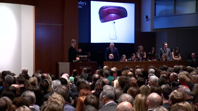 atmosphere items introduction and auction at jony and marc's auction at sotheby's on in new york city - versteigerung stock-videos und b-roll-filmmaterial