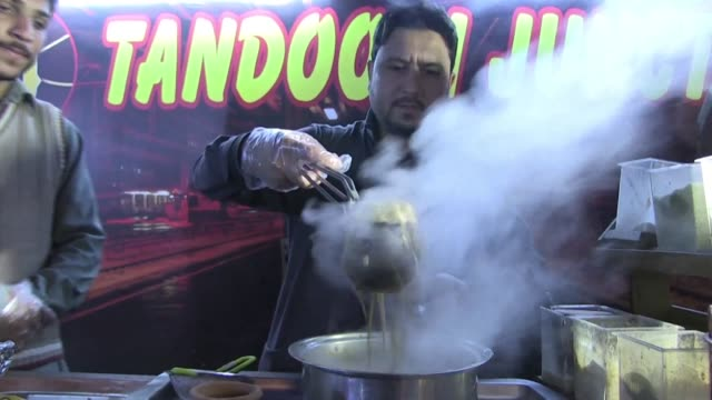 it's a cuppa like no other every evening in islamabad a crowd arrives at sanaullah's street stall to taste his tandoori chai milk tea served in... - tea hot drink stock videos & royalty-free footage