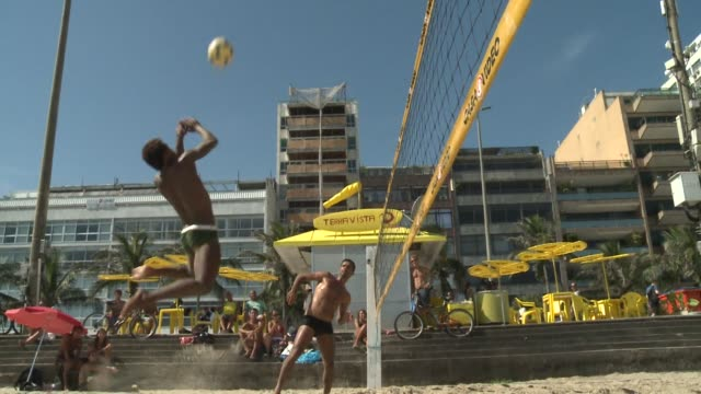 stockvideo's en b-roll-footage met it's all about the ball this year in brazil 2014 football world cup host in all its variations voiced footvolley a brazilian beach love affai on... - wereldkampioenschap sport