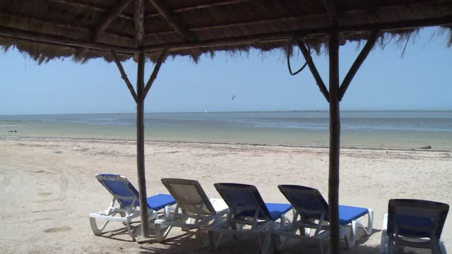 its another sun drenched day but the deckchairs of a four star hotel on the island of djerba stand empty in a sign of the catastrophic summer on the... - star island stock videos & royalty-free footage