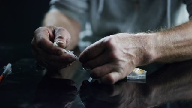 it's like poison and poison kills - heroin stock videos & royalty-free footage