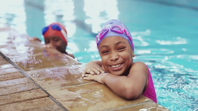 it's never too early to learn to swim - girl swimming costume stock videos & royalty-free footage