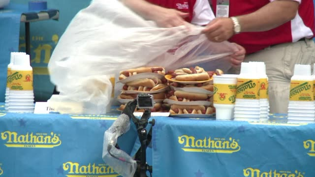 its one of americas fourth of july tradition the worlds biggest hot dogs eaters competed in coney island in new york - biggest stock videos & royalty-free footage